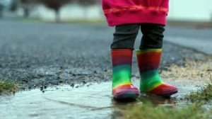 stock-footage-kid-jumping-in-puddle-slow-motion-rainbow-rubber-boots-300x168